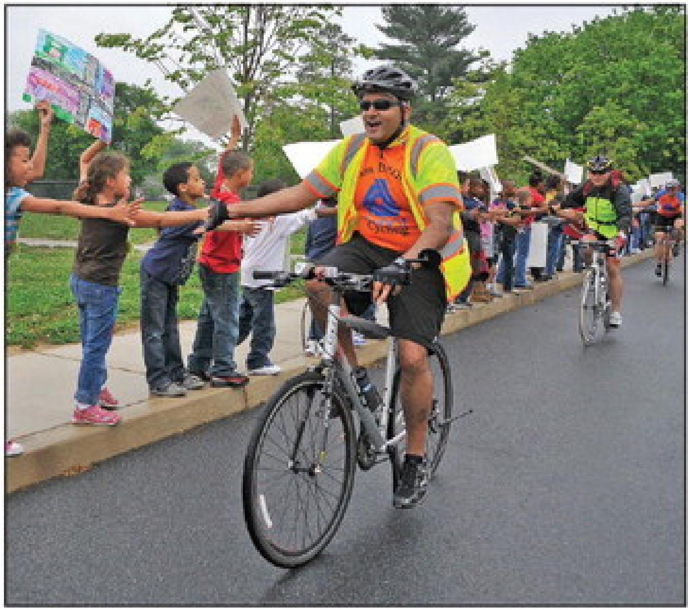 Delaware Department of Transportation Secretary Shailen Bhatt is greeted by South Dover Elementary School pupils Wednesday as he rides in to celebrate Bike To School Day.